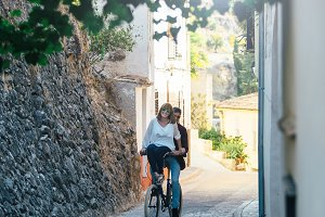 Lovely couple riding bike together