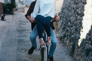 Laughing couple riding bike