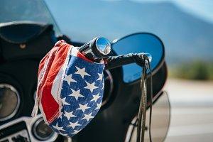 Colorful bandanna on bike handlebar