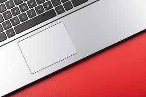 Laptop on red background. Horizontal shoot.