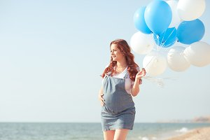 Happy pregnant with balloons