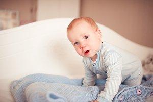 Baby boy indoors