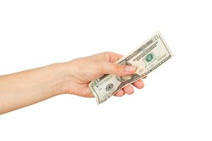 Twenty dollars in the woman's hand, isolated on white