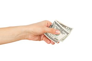 One hundred and twenty dollars in the woman's hand, isolated on white