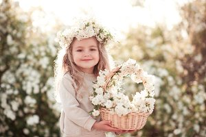 Smiling girl with flowers