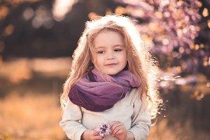 Kid girl in sun light