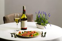 Seafood salad with tuna on white tablecloth background
