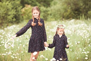 Two sisters in meadow