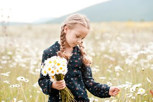 Kid girl in field