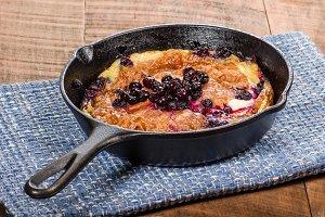 Blueberry croissant breakfast in skillet