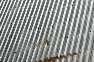 Corrugated metal sheet for background