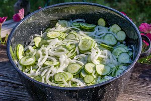 Metal bowl with sliced pickles