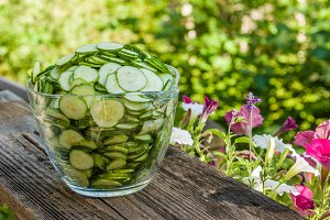 Glass bowl with sliced pickles