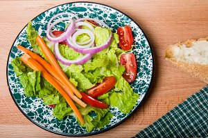 Fresh green salad with bread