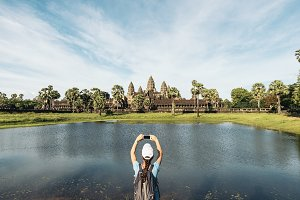 Woman taking picture to Angkor Wat.