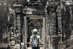 Woman walking around Angkor Wat.