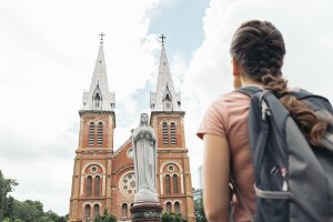 Woman backpacker looking one church.