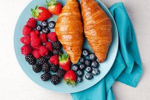 Summer breakfast on a blue plate.