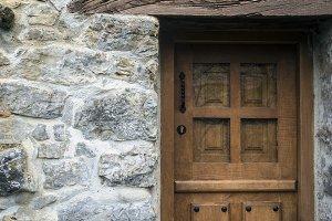 A wooden door in stone cottage