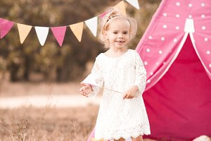 Smiling baby girl outdoors