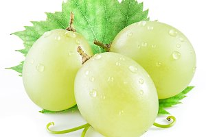 Three grapes with leaf