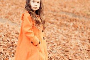 Stylish baby girl outdoors