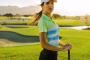 Young female golfer with golf club