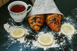 Croissants with chocolate and lemon tea