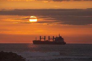 ship cargo at sunset.
