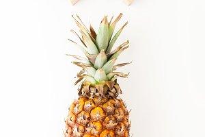 hand holding ripe pineapple