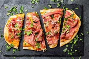 Pizza with ham serrano