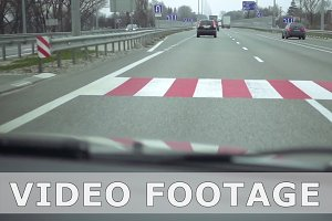 View from car to highway pedestrian crossing