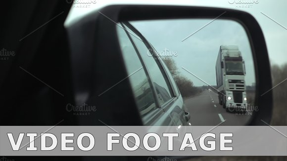Side Mirror View Of Passing The Truck On Highway