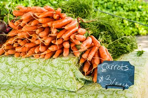 Fresh bunches of carrots at the market