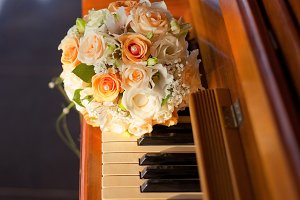 Pastel wedding bouquet with orange