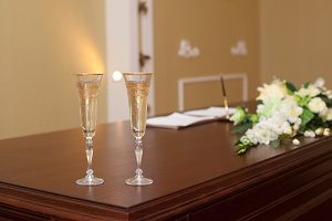 Golden wedding wineglass on table