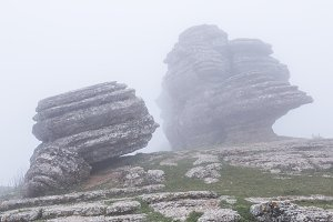 Gigantic rocks in fog