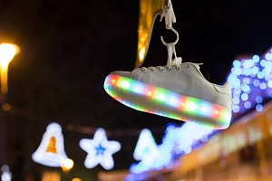 Shoe hanging on blurred background
