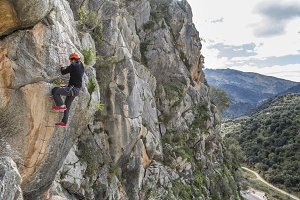 Woman climbing a via ferrata