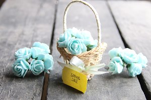 spring sale tag and flowers in a small basket