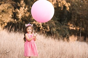 SMiling baby with balloon