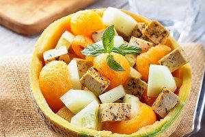 Vegan salad with melon and tofu cheese