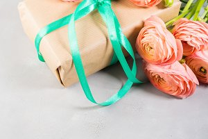 Gift box and pink flowers