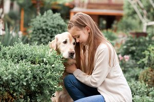 Girl with sad dog