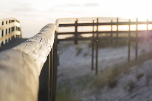 Beach fence sunset