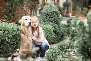 Smiling baby girl with dog