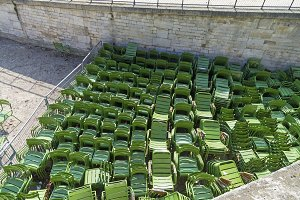 A lot of green iron chairs.