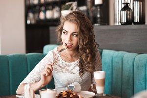 Girl eating in cafe