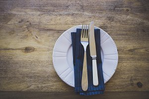 Cutlery on Plate on Rustic Table