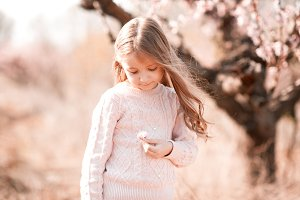 Child girl with flower